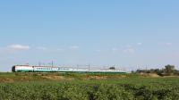 Intercity da Roma Termini per Trieste Centrale affidato alla E402 127, in transito tra le campagne di Castiglion del Lago e Terontola Cortona.